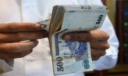 تقرير أميركي: الريال سينخفض أمام الدولار في ظل أزمة المملكة