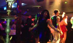 فتاة شبه عارية ترقص في أحدى بارات الحلال